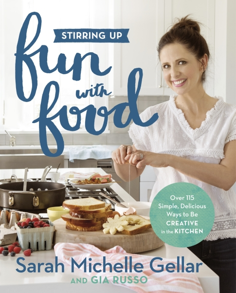 """This cover image released by Grand Central Life & Style shows """"Stirring Up Fun with Food: Over 115 Simple, Delicious Ways to Be Creative in the Kitchen,"""" by Sarah Michelle Gellar and Gia Russo. - AP"""