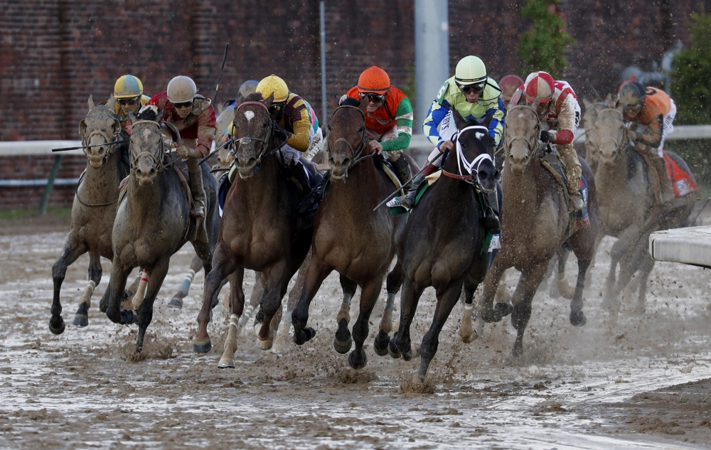 John Velazquez (light green shirt) aboard Always Dreaming leads the field to the final stretch and wins the 2017 Kentucky Derby at Churchill Downs in Louisville Saturday. — Reuters