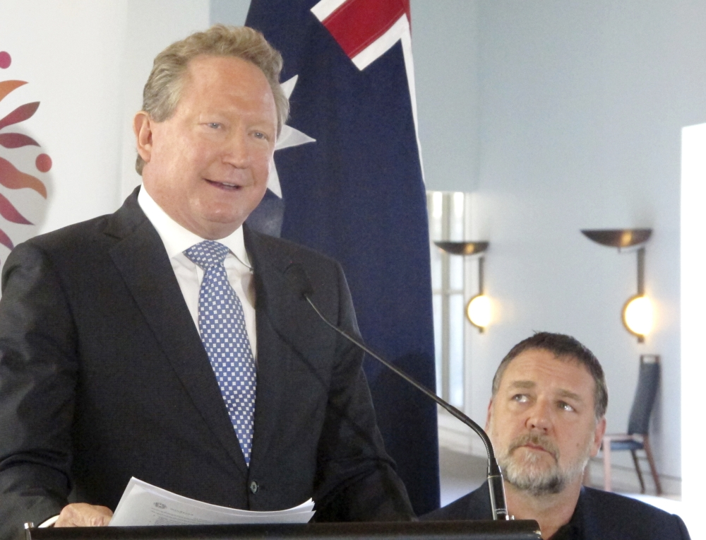 Iron ore mining magnate Andrew Forrest, left,  gives a speech at Australia's Parliament House in Canberra, Australia, on Monday, May 22, 2017, as actor Russell Crowe looks on. — AP