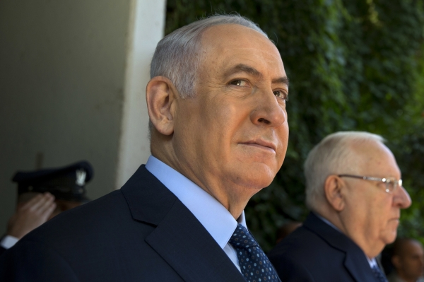 Israeli Prime Minister Benjamin Netanyahu, left, stands with Israel's President Reuven Rivlin prior to their meeting with Rwanda's President Paul Kagame (not in picture) at the President's residence in occupied Jerusalem on Monday. — AP