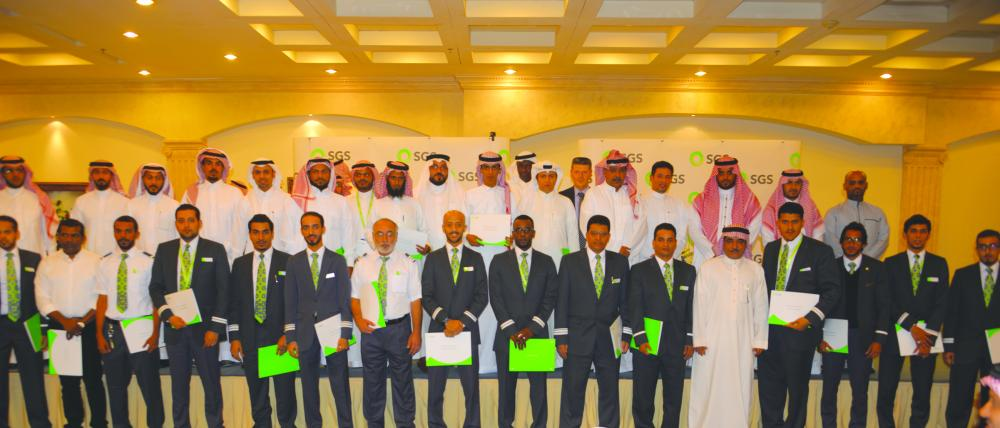 The CEO of SGS Qaid Bin Khalaf Al Otaib, together with other senior executives, pose for a group photo with the awardees