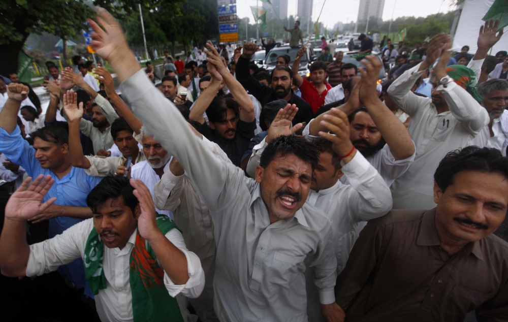 Supporters of Pakistan's deposed Prime Minister Nawaz Sharif chant slogans at a rally to to condemn the dismissal of their leader in Islamabad on Saturday. — AP