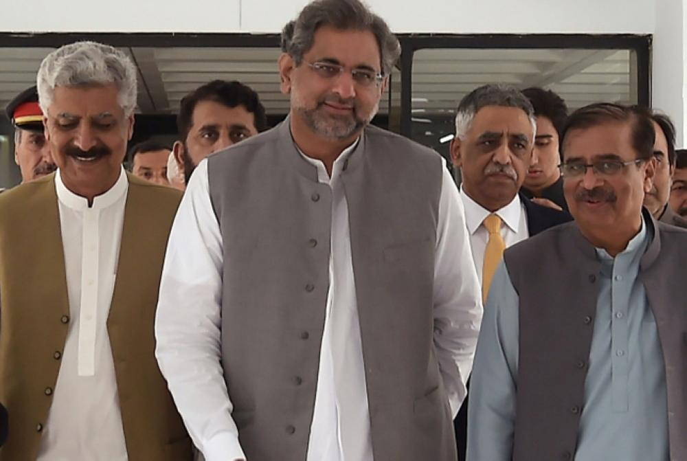 Pakistan's prime minister-designate Shahid Khaqan Abbasi (center) leaves with his party leaders after a meeting at Parliament House in Islamabad, Tuesday. — AFP