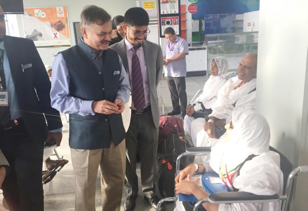 Ahmad Javed Ambassador of India (left), and Md. Noor Rahman Sheikh Consul General of India (behind him), welcome pilgrims on their arrival in the Kingdom. — Courtesy photo