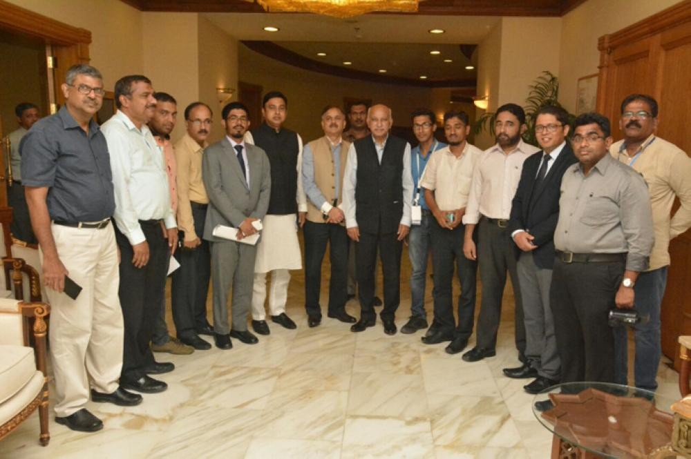 M.J. Akbar posing for a group photo with Syed Zafar Islam, Indian diplomats and media persons.