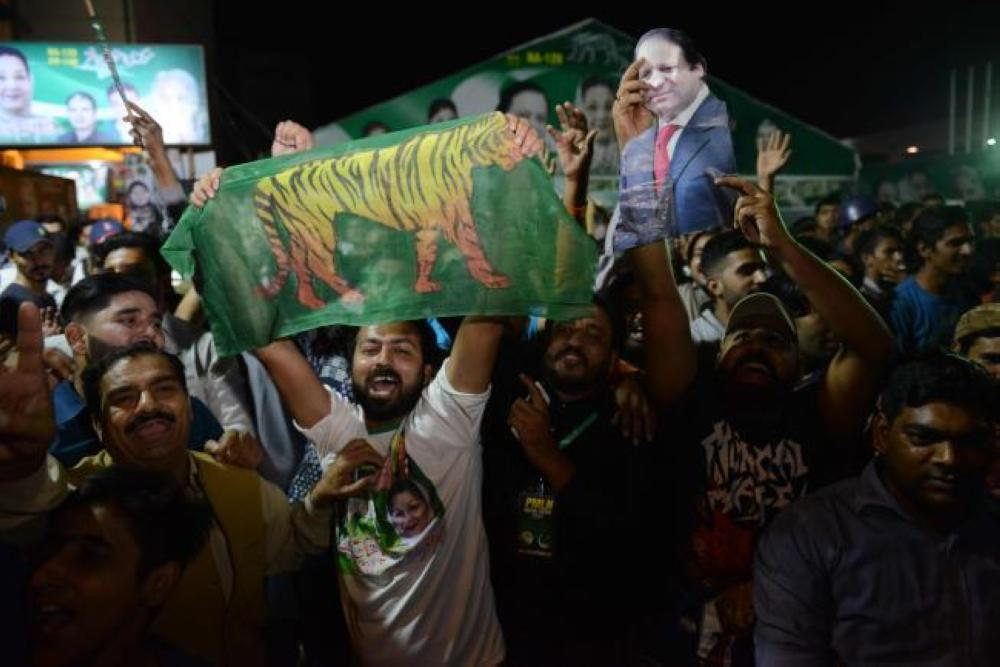 Activists of former Pakistani prime minister Nawaz Sharif party celebrate victory in by-election in Lahore on Sunday —  AFP