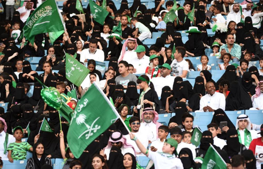 Saudi families sit in a stadium to attend an event in the capital Riyadh on September 23, 2017 commemorating the anniversary of the founding of the Kingdom. — AFP