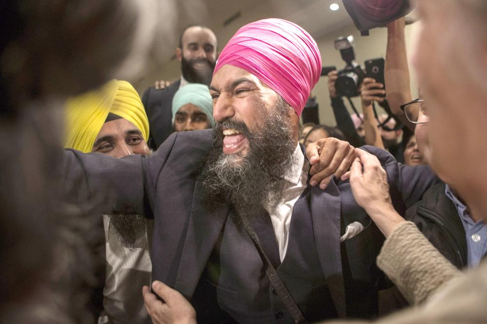 Jagmeet Singh celebrates with supporters after his first-ballot triumph in the contest for leader of the leftist New Democrat party in Toronto on Sunday. — AP