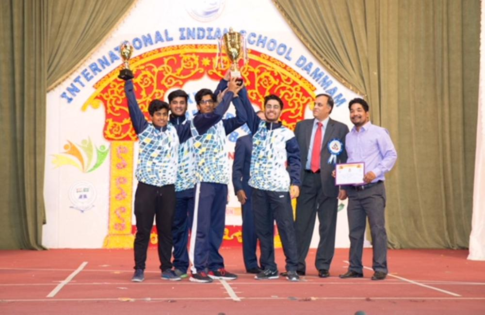 Chief guest Dr. Suhail Ajaz Khan, Deputy Chief of Mission, Embassy of India, Riyadh, presenting the trophy to winners. — Courtesy photos