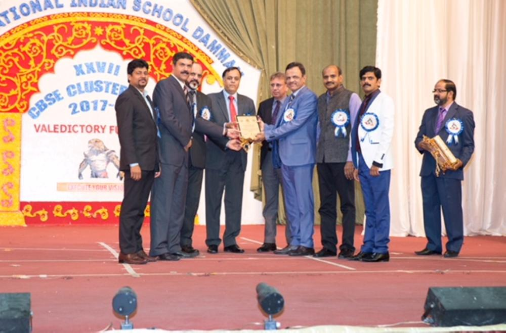 Chief guest Dr. Suhail Ajaz Khan, Deputy Chief of Mission, Embassy of India, Riyadh, being presented a memnto by the IISD SMC with Dr. Hifzur Rahman, first secretary and observer of Indian schools in the Kingdom on the stage.