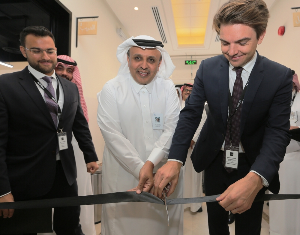 Rumaih bin Mohammad Al-Rumaih, president of the Public Transport Authority (PTA), presides over the cutting of ceremonial ribbon assisted by Pierre-Dimitri Gore-Coty, VP & RGM EMEA, Uber