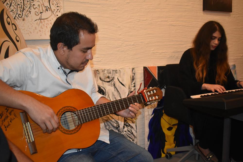 Saudi musicians Ahmad Enaya, left, and Shatha Al-Thaqafi perform at Arbab Al-Heraf coffee shop.