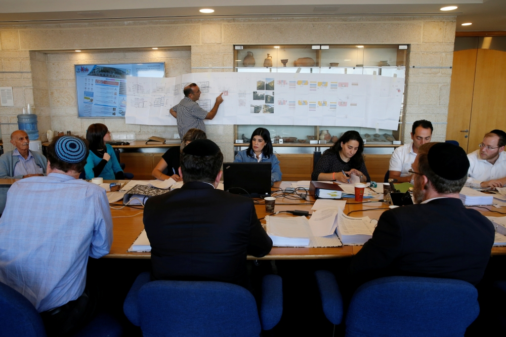 People participate in a municipal committee to discuss the approval of 176 new housing units to be built in the Jewish settler enclave of Nof Zion, located in the heart of East Jerusalem's Palestinian neighborhood of Jabel Al-Mukaber, at the Jerusalem Municipality on Wednesday. — Reuters