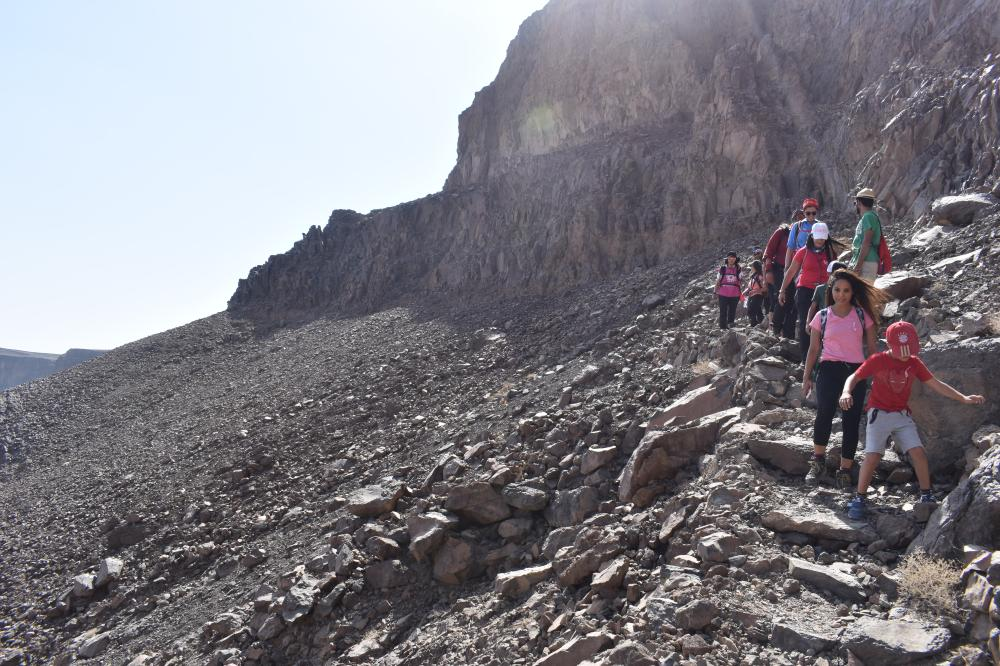 The participants of the breast cancer awareness trip going all the way down into the Wahba crater.