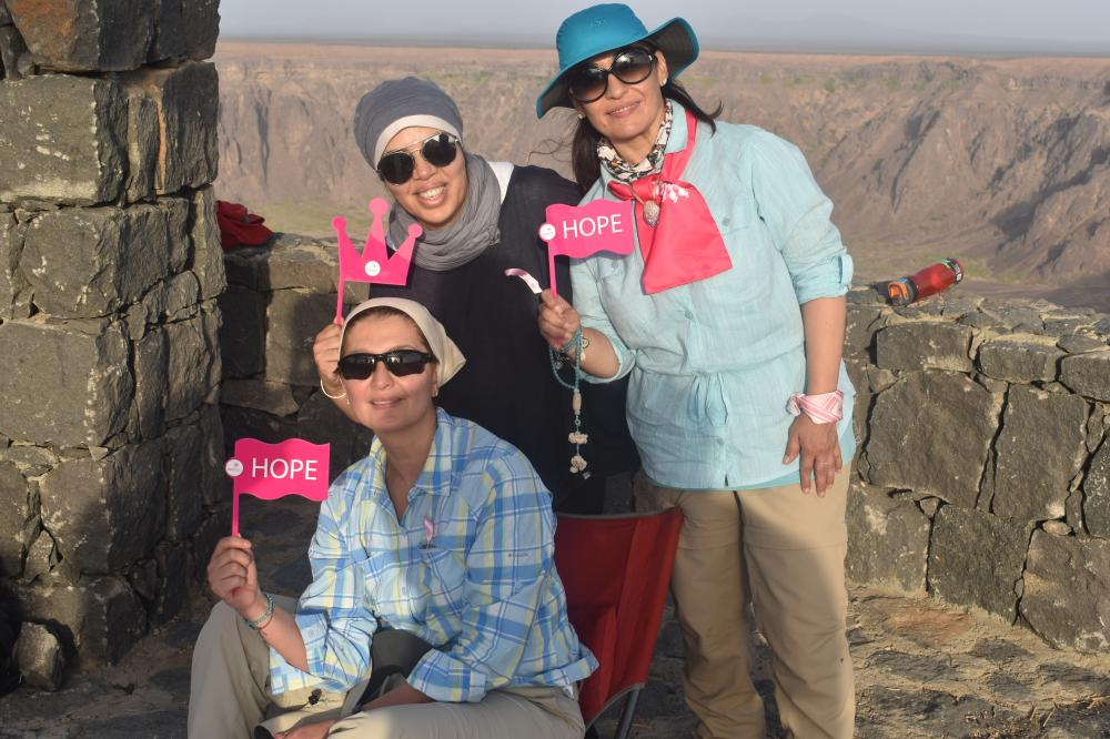 Members of the ambassadors of Zahra group of volunteers who promote breast cancer awareness during the trip at Wahba Crater