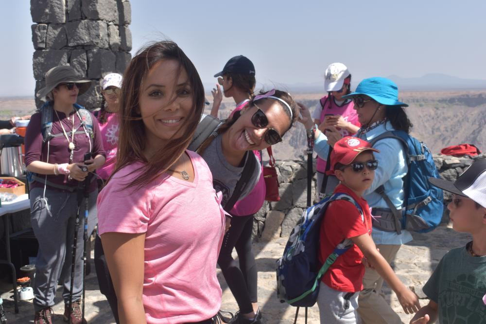 Yasmin Gahtani with a friend of her in the breast cancer awareness hiking trip at Wahba Crater.