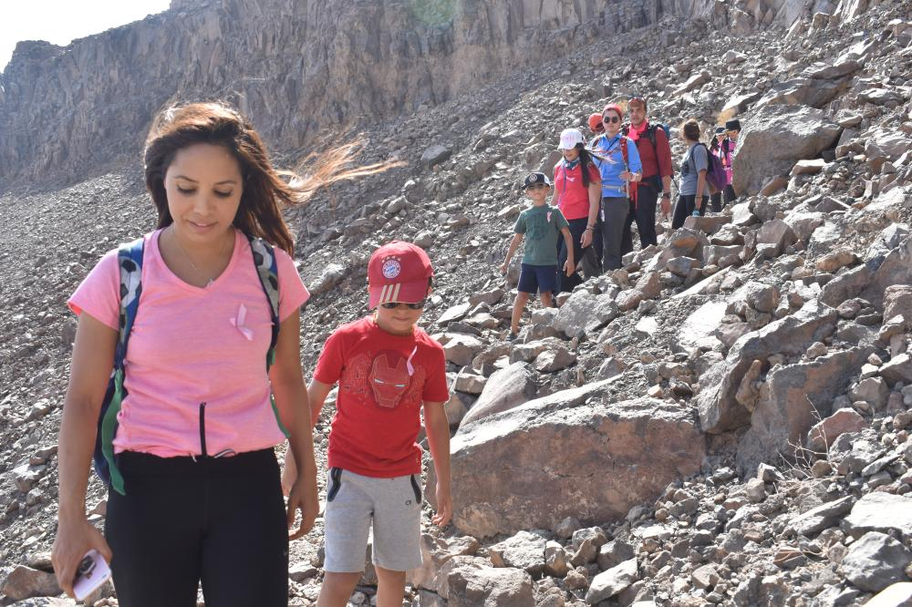 Yasmin Gahtani and her son hiking at Wahba Crater with other members of Qimmam club.