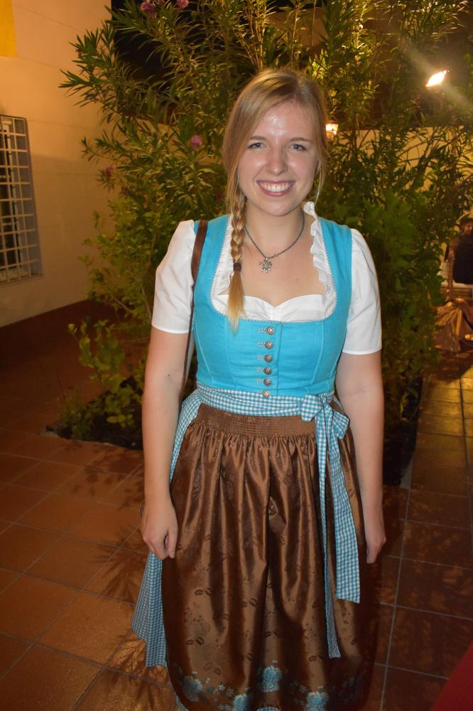 A German woman celebrating the Unity Day by wearing the traditional German dress.