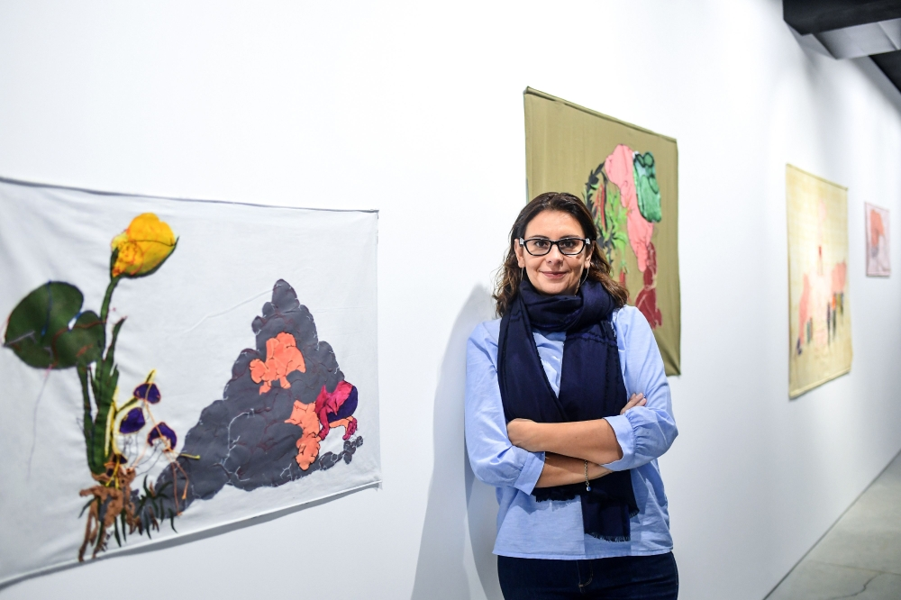 Asli Sumer, owner of the gallery Art Sumer, poses during an interview in Istanbul.  — AFP