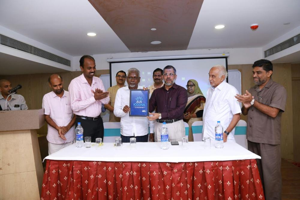 Calicut University Vice Chancellor Dr. K. Mohammed Basheer unveils the logo of ICCOSA in the presence of O. Abdurrahman, group editor of Mediaone Madhyamam, and other dignitaries. — SG photo