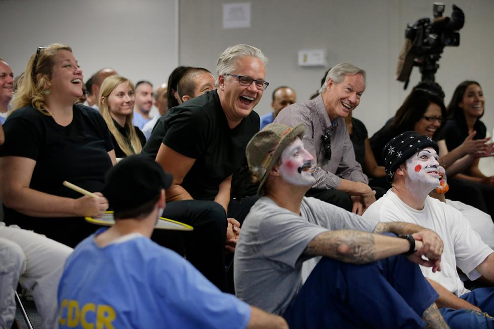 Actor Tim Robbins shares a light moment with participants during a drama program that is a part of The Prison Project, in downtown Los Angeles, California.