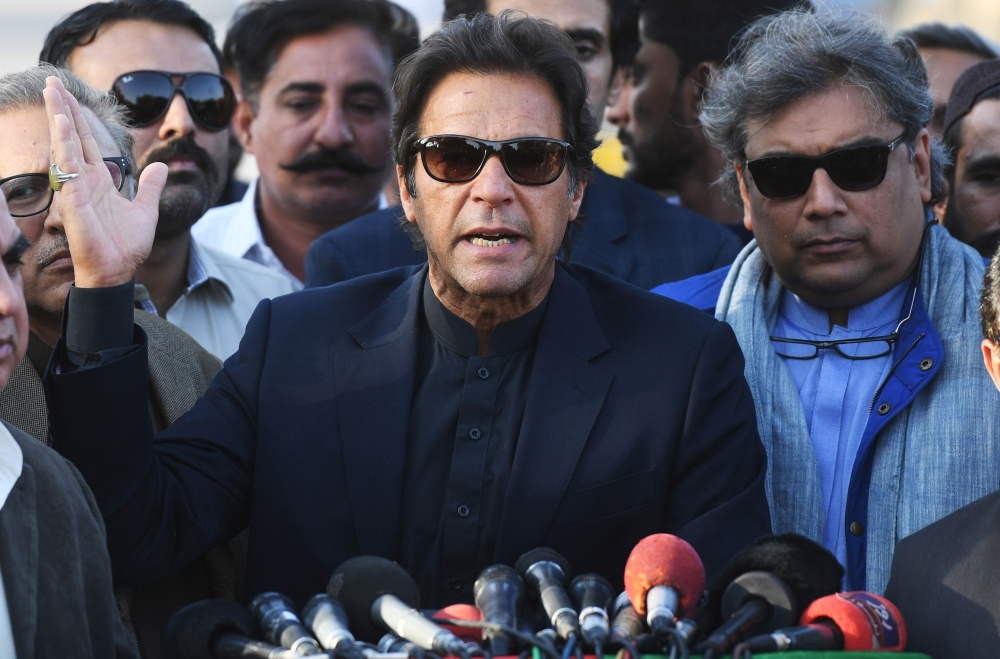 Pakistani cricketer-turned-opposition leader Imran Khan (C) gestures as he addresses the media in Karachi on Friday. Pakistan's Supreme Court dismissed a graft case against Imran Khan Friday, ensuring he will contest a general election due next year, just months after the same body ousted ex-prime minister Nawaz Sharif. Khan had faced being disqualified from holding political office over charges including unreported assets. — AFP