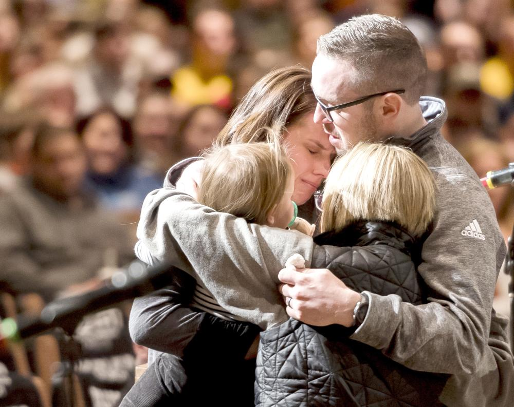 Gracie Zacakri, left, is embraced by her small group as family, friends, and community attended a remembrance and candlelight vigil for Deputy Zackari Parrish at Mission Hills Church in Littleton, Colorado. on Monday. — AP