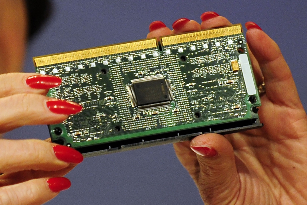 This file photo shows an Intel processor in Brussels. Amid a frantic rush to patch a computer security flaw, experts struggled on Friday to determine the impact of a newly discovered vulnerability which could affect billions of devices worldwide. Computer chipmaking giant Intel — the focus of the first reports on the flaw — said the company and its partners