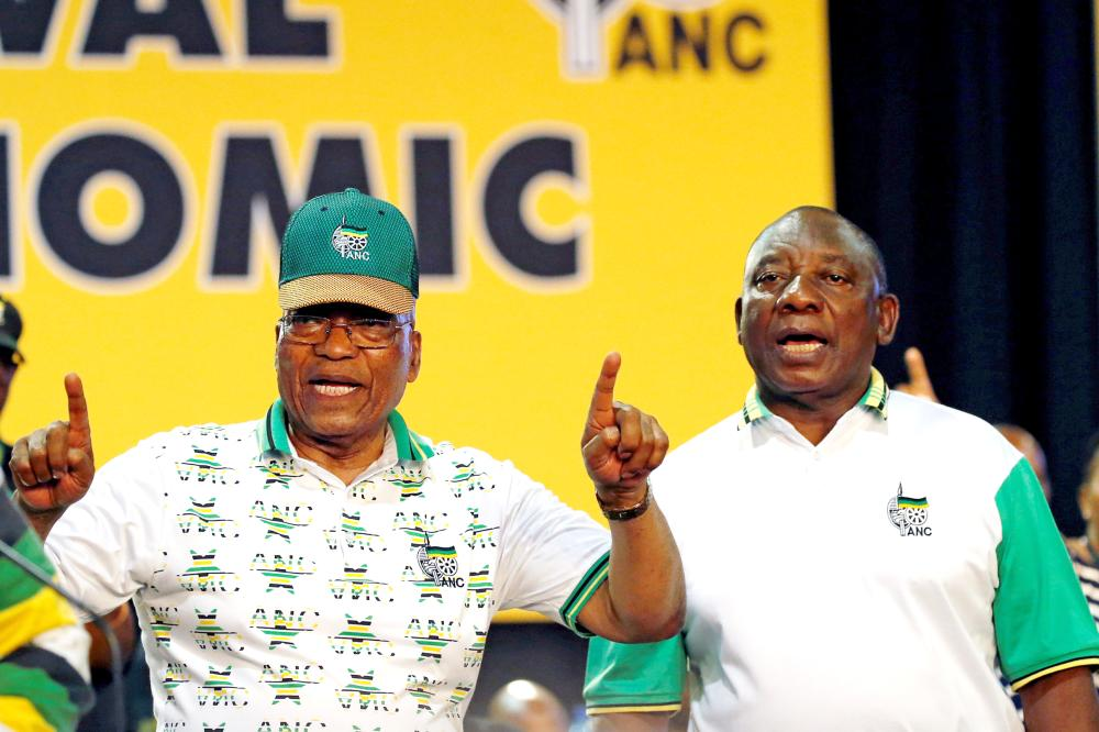 South African President Jacob Zuma sings next to newly elected president of the ANC Cyril Ramaphosa during the 54th National Conference of the ruling African National Congress (ANC) at the Nasrec Expo Centre in Johannesburg, South Africa, in this Dec. 18, 2017 file photo. — Reuters