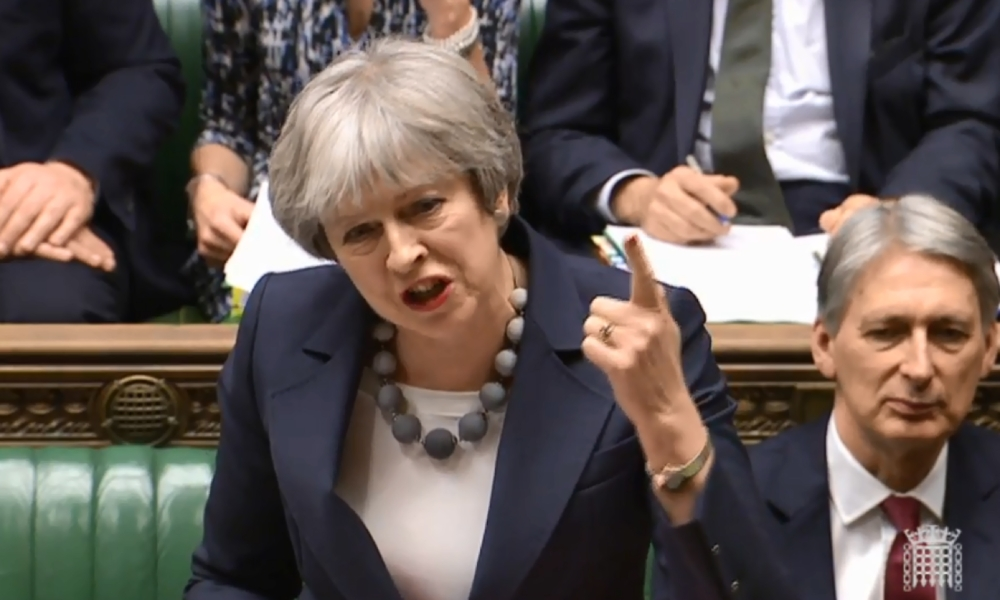 A video grab from footage broadcast by the UK Parliament's Parliamentary Recording Unit (PRU) shows Britain's Prime Minister Theresa May speaking during the weekly Prime Ministers Questions (PMQs) session in the House of Commons in central London on Wednesday. — AFP