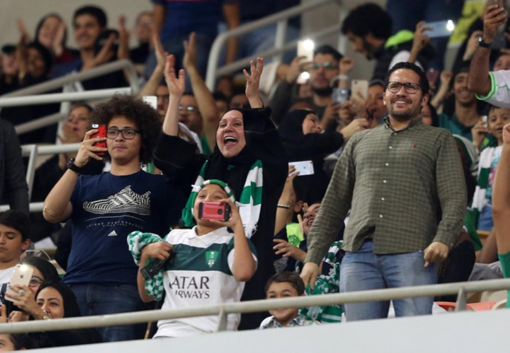 Female Saudi supporters of Al-Ahli attend their teams football match against Al-Batin in the Saudi Pro League at the King Abdullah Sports City in Jeddah on Friday. —AFP