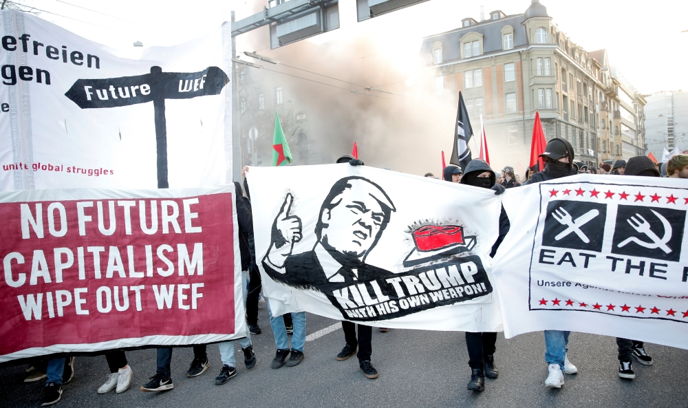 Protesters with banners march during an anti-WEF and anti-US President Donald Trump demonstration, ahead of Trump's visit to the World Economic Forum (WEF), in Bern, Switzerland, on Saturday. — Reuters