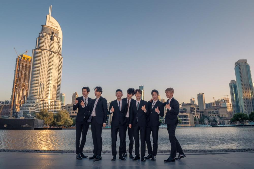 Korean Supergroup EXO poses in front of The Dubai Fountain in Emaar's Downtown Dubai.