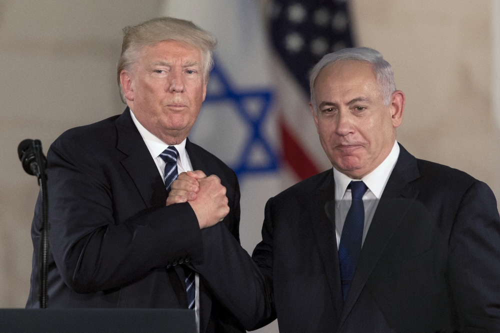 In this May 23, 2017 file photo, US President Donald Trump, left, shakes hands with Israeli Prime Minister Benjamin Netanyahu at the Israel Museum in occupied Jerusalem. — AP