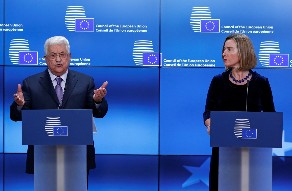 Palestinian President Mahmoud Abbas and European High Representative for Foreign Affairs Federica Mogherini give a press statement before a meeting with European Union foreign ministers in Brussels, Belgium, Monday. — Reuters