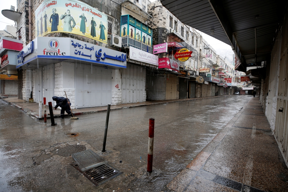 Closed shops are seen in the West Bank city of Nablus on Tuesday as Palestinians call for a general strike protesting the visit of US Vice President Mike Pence in Jerusalem. — Reuters