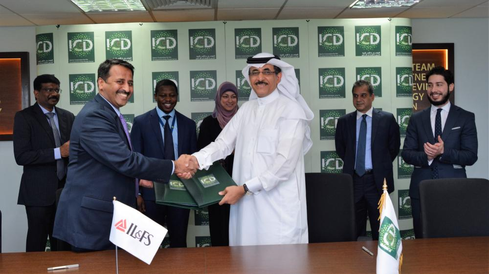 Khaled Al-Aboodi, chief executive officer of ICD, and Krishna Kumar, chief executive officer of IIML at the signing of the agreement in Jeddah. Also seen in the photo is Adeeb Ahmad, deputy CEO of ICD, second right, and other officials. — Courtesy photos