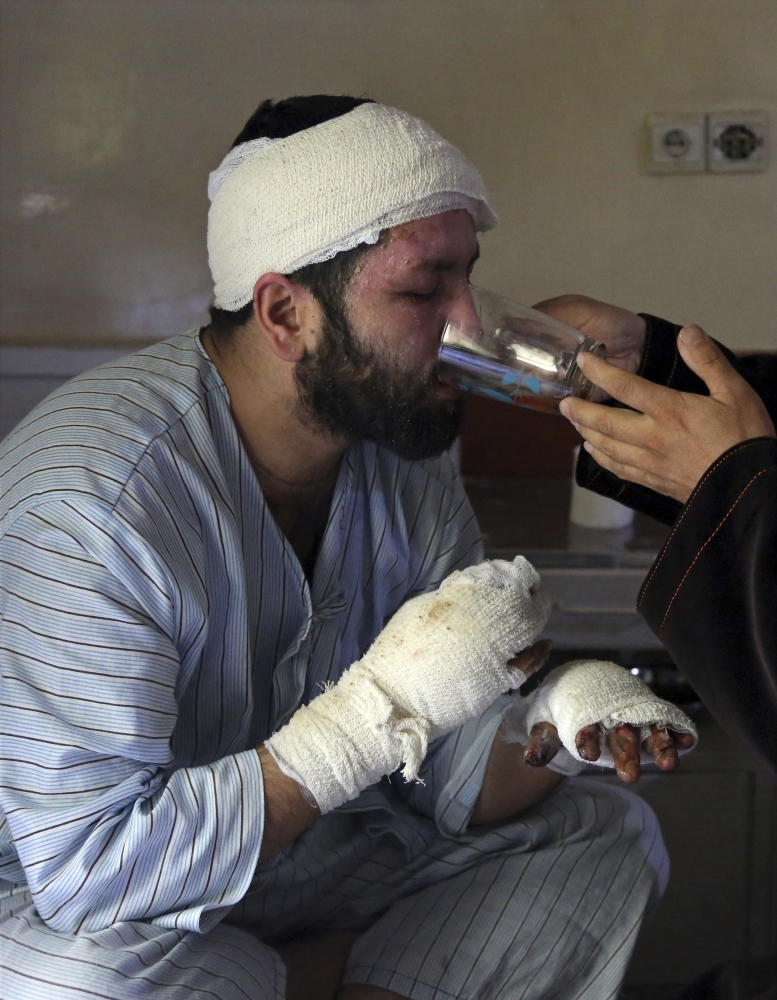 Sayed Mushtaq Hossaini, 26, who was injured in a suicide attack, drinks tea at a hospital in Kabul, Afghanistan. — AP
