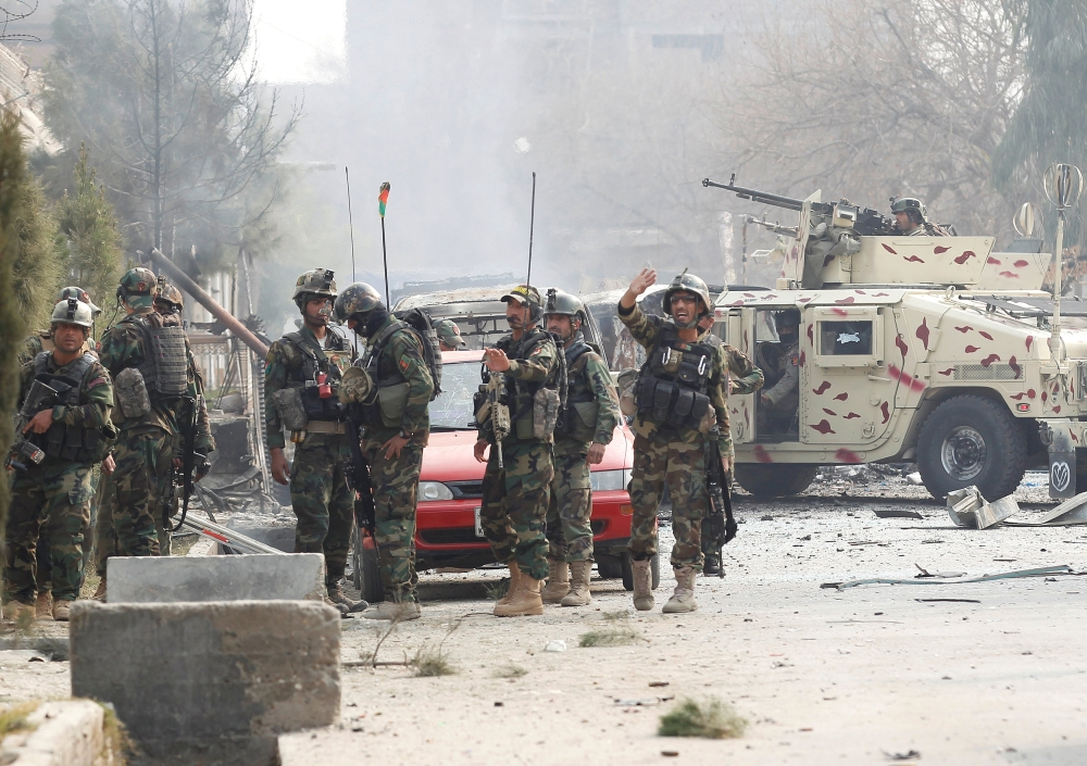 Afghan security forces arrive at the site of a blast and gun fire in Jalalabad, Afghanistan, on Wednesday. — Reuters