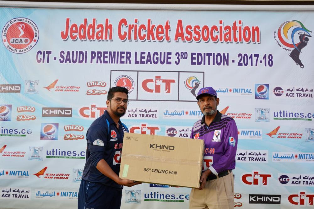Farhan of ARM United receiving award from Syed Ashfaq Hussain.