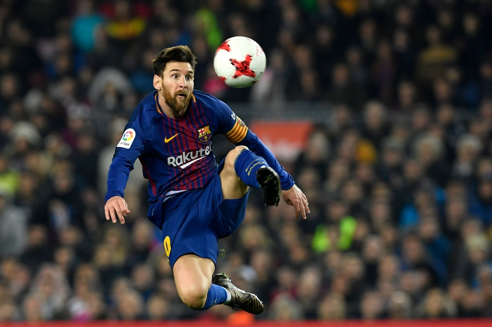 Barcelona's Argentinian forward Lionel Messi controls the ball during the Spanish 'Copa del Rey' (King's Cup) quarterfinal second leg football match against RCD Espanyol at the Camp Nou Stadium in Barcelona on Thursday. — AFP