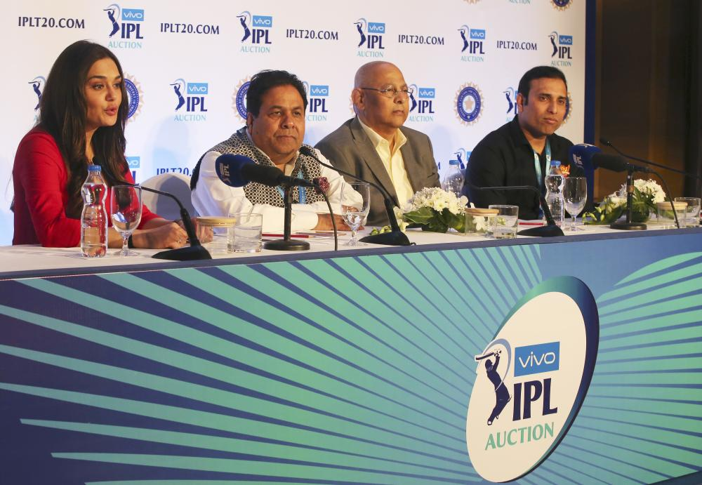 (From L) Bollywood actor and Kings XI Punjab team owner Preity Zinta, IPL Chairman Rajeev Shukla, Board of Control for Cricket in India Secretary Amitabh Choudhary and Sunrisers Hyderabad team mentor V.V.S. Laxman attend a press conference during the first day of the Indian Premier League (IPL) player auction in Bangalore Saturday. — AP