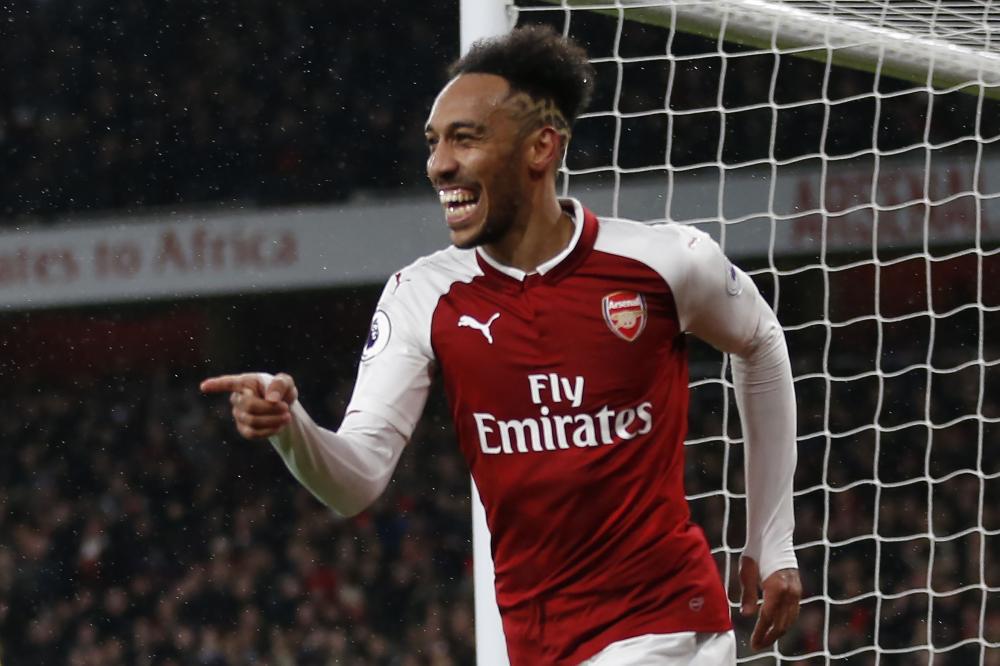 Arsenal's Gabonese striker Pierre-Emerick Aubameyang celebrates scoring during the English Premier League football match against Everton at the Emirates Stadium in London Saturday. — AFP