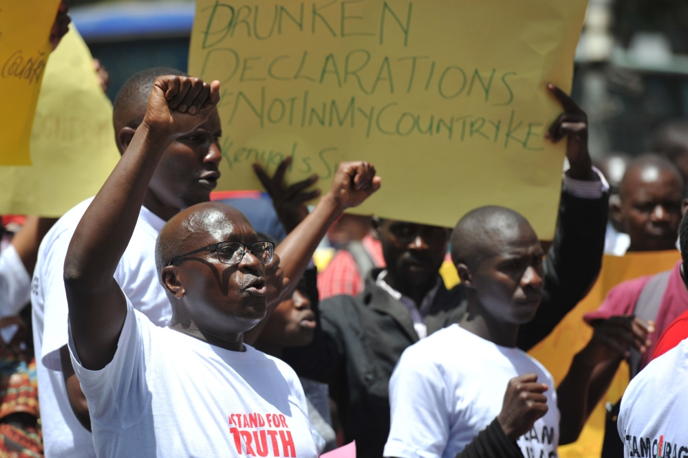 "Civil rights activists demonstrate on Monday in the streets of Nairobi to protest against the shutdown of three major TV channels to stop them from broadcasting  a ""swearing-in"" of opposition leader on Jan. 30. — AFP"