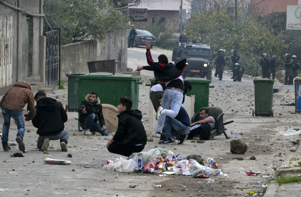 Palestinian youths clash with Israeli forces in the village of Yamoun, on the outskirts of Jenin, in the occupied West Bank on Tuesday following an operation by the Israeli army. — AFP