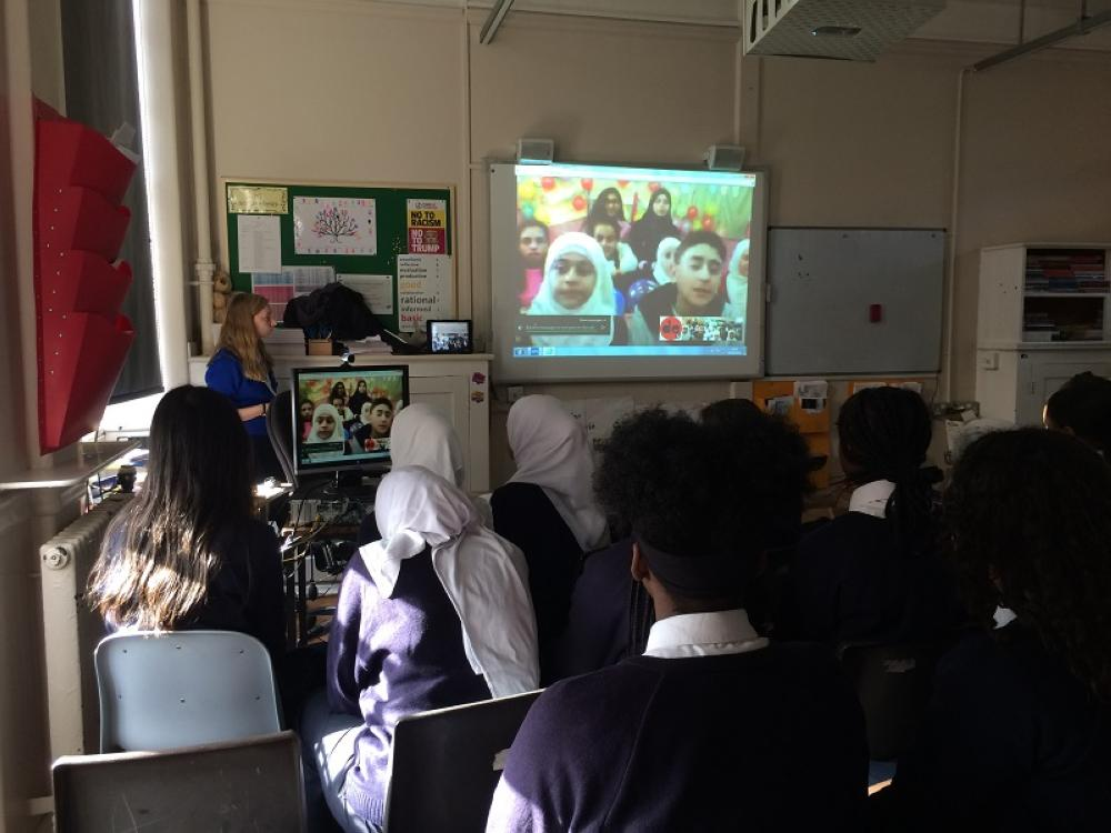 British students at the Connaught School for Girls in London connect via a video call with Palestinian refugee students from Al Fallouja and Haifa schools in Damascus, Syria, which is run by aid agency United Nations Relief and Welfare Agency (UNRWA). - Thomson Reuters Foundation