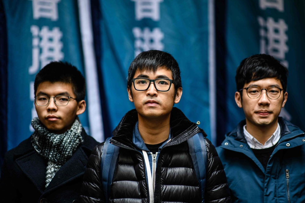 Hong Kong's leading democracy activists (left to right) Joshua Wong, Nathan Law and Alex Chow arrive outside the Court of Final Appeal in Hong Kong on Tuesday. — AFP