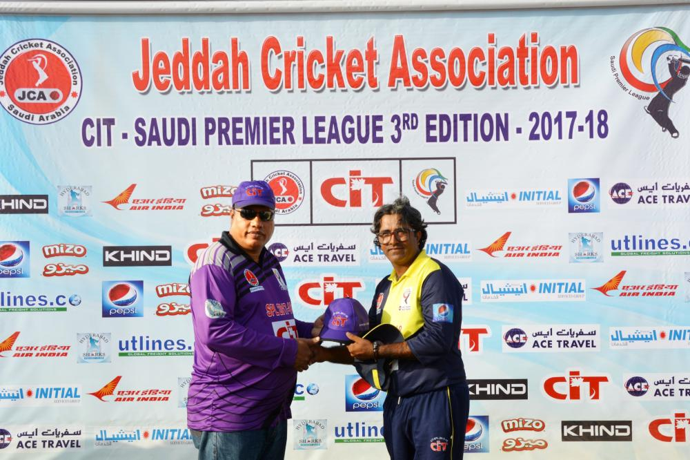 Rana Shehzad receiving the Purple Cap from Haroon Abdullah