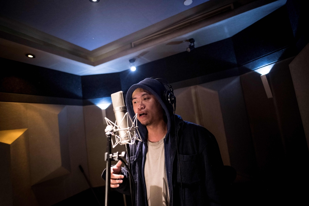 Shanghai rapper Naggy singing in his studio. Chinese rap and hip hop seemed poised to break out after a wildly popular singing show, but an abrupt backlash has tamed the swagger of artists who fear the music scene will be nipped in the bud by Communist politics. — AFP