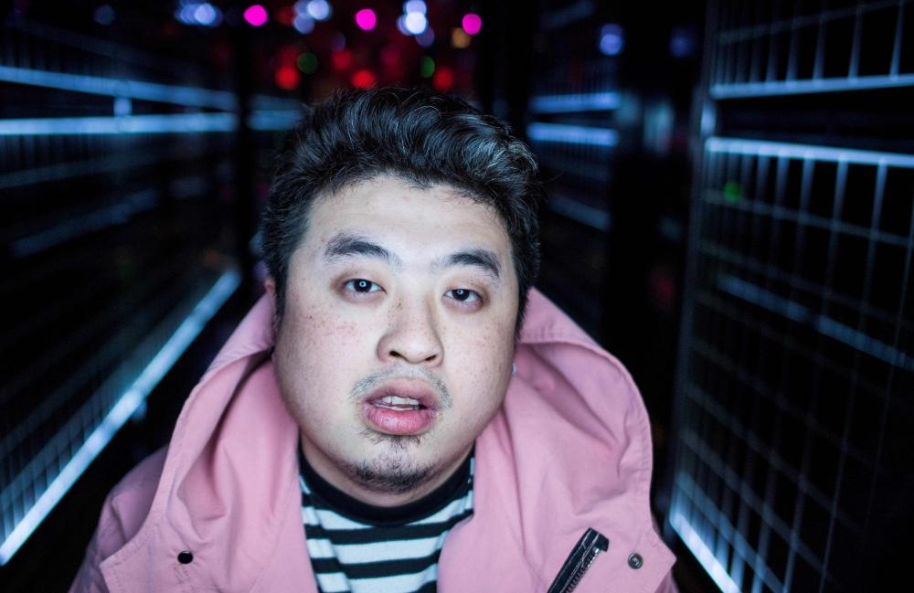 Shanghai rapper Mr Trouble, Hong Tianlin, posing outside his studio in Shanghai.